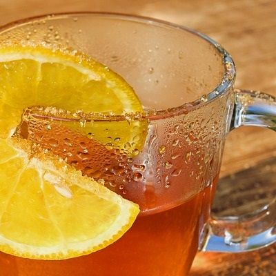 Glass cup with hot honey and lemon